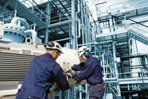 industrial_workers_inside_oil_refinery