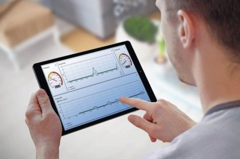Smart_home_control_on_tablet._Interior_of_living_room_in_the_background.