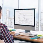 Rear_view_of_Caucasian_male_graphic_designer_working_on_computer_at_desk_in_a_modern_office;_Shutterstock_ID_1434063164;_Purchase_Order:_-