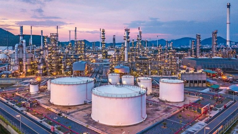 Aerial_top_view_oil_and_gas_chemical_tank_with_oil_refinery_plant_background_at_twilight.